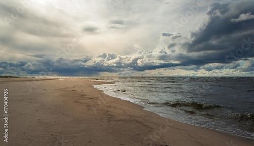 Fényképezés  Windy cloudy day at the Baltic bay, Vidzeme, Latvia