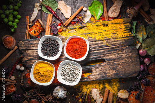 Stampe  Selection of spices herbs and ingredients for cooking, Food background on wooden table, Top view, Thai cuisine