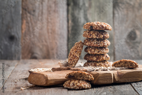 Aluminium Prints Candy Oatmeal cookies on cutting board
