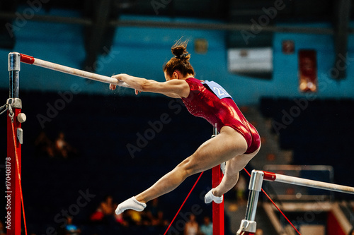 uneven bars female gymnast to competition in artistic gymnastics Canvas Print