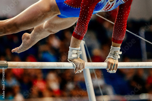 Tuinposter Gymnastiek uneven bars athlete gymnast to competition in artistic gymnastics