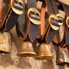 Swiss Cowbells Hanging At An Farm In The Alps