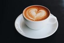 Coffee Latte Art A Shape Of Heart On Table In Coffee Shop.