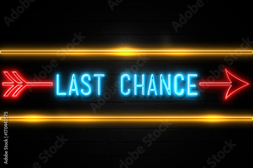 Photo  Last Chance  - fluorescent Neon Sign on brickwall Front view