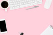 canvas print picture - Pink pastel woman office desk with computer gadgets, coffee, smartphone and supplies. Top view with copy space, flat lay.
