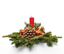 Christmas Centerpiece With Candle Against White Background