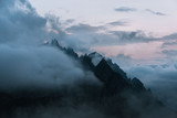 Dolomites mountains during sunset covered in clouds - 170472930
