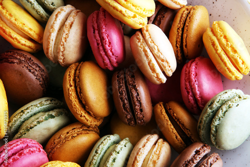 Fotografía Sweet and colourful french macaroons or macaron on white background, Dessert