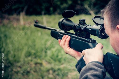 man with airgun