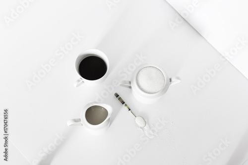taza de cafe, azucar y lechera