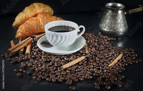 Papiers peints Café en grains Still life with a porcelain cup of coffee and croissants in a retro style