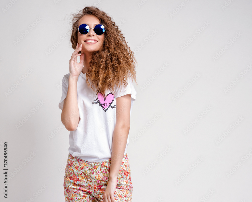 Fototapeta Cool hipster student woman wearing eyewear glasses . Caucasian female university student looking at camera smiling happy