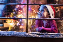 On Christmas Night A Lovely Little Girl Looking Out The Window
