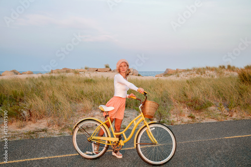Fotobehang Fiets Beatiful woman with bike on the beach