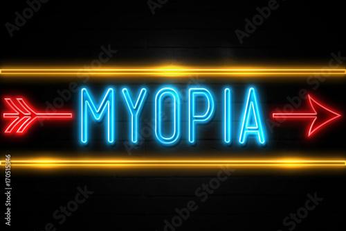 Fotografía  Myopia  - fluorescent Neon Sign on brickwall Front view