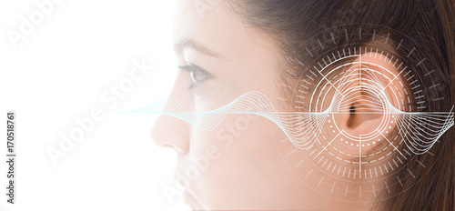 Fotografia  Hearing test showing ear of young woman with sound waves simulation technology
