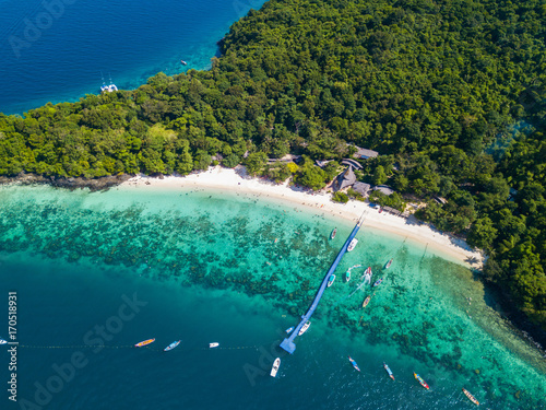 Aerial view or top view of tropical island beach with clear water at Banana beach, Coral Island, Koh Hey, Phuket