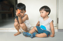 Two Little Brother Playing Gun...