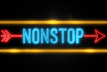 Nonstop  - Fluorescent Neon Sign On Brickwall Front View