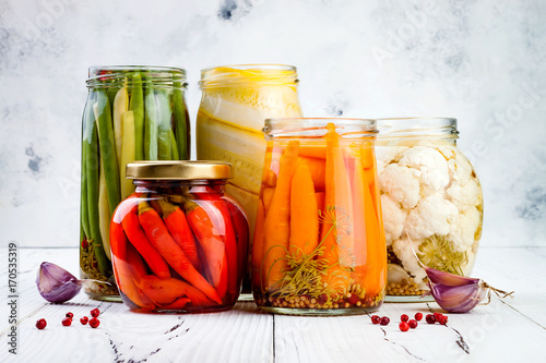 Photographie Marinated pickles variety preserving jars