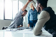 Leinwandbild Motiv Two colleagues giving high five during meeting