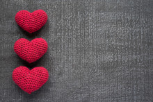 Crocheted Red Hearts On A Grunge Board