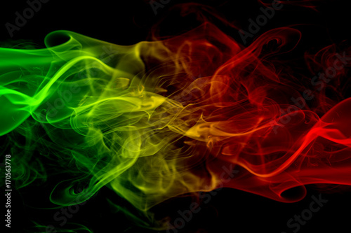 abstract background smoke curves and wave reggae colors green, yellow, red color Canvas Print