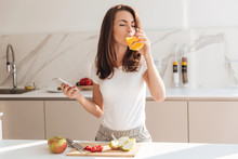 Young Joyful Woman Drinking Orange Juice