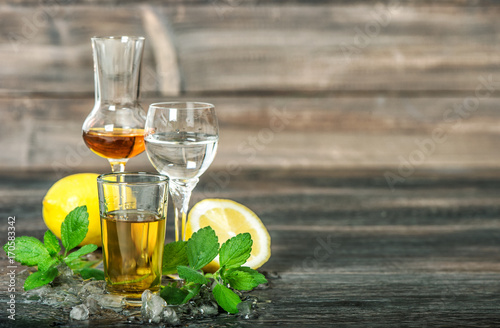 Alcoholic drinks ice lemon mint leaves whiskey gin rum vodka