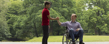 Disabled Man Greeting With Fri...