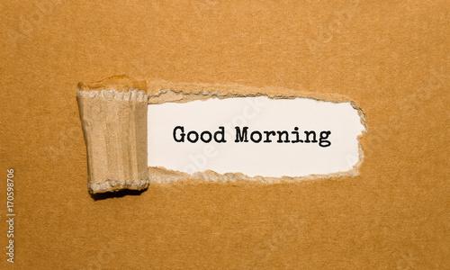 Obraz na płótnie The text Good Morning appearing behind torn brown paper