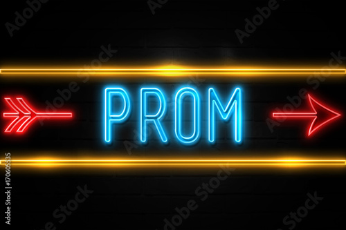 Photo  Prom  - fluorescent Neon Sign on brickwall Front view