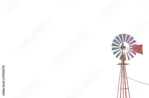 Old rustic windmill isolated with room for copy.