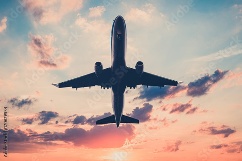 Fotografering  airplane on sunset sky  - jet, flying airplane