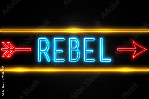 Photo Rebel  - fluorescent Neon Sign on brickwall Front view