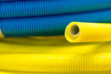 Yellow And Blue Corrugated Plastic Tube.