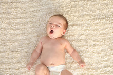 Cute Little Baby Lying On Soft...