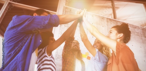 Fotografie, Obraz  Business people giving high five in creative office