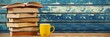 Stack of books with cup on table