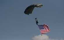 Sky Diver Carrying American Flag With Parachute.