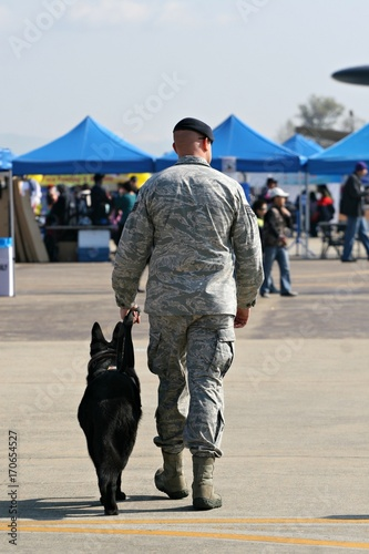 A United States soldier with his German shepherd war-dog,. Canvas Print