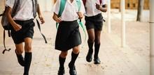 Smiling School Kids Running In...