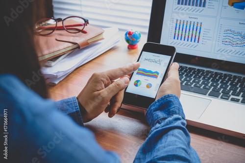 Businesswoman analyzing financial data - 170664971