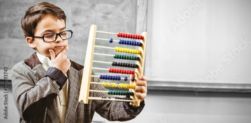 Pupil dressed up as teacher holding abacus Canvas Print
