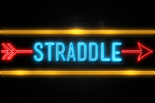 Straddle  - Fluorescent Neon Sign On Brickwall Front View
