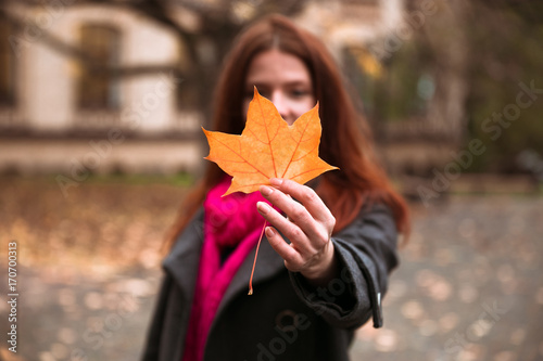 Spoed Foto op Canvas Canada Happy woman walking in autumn city park. Rainy weather and yellow trees around
