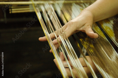 Fotografie, Obraz  weaving and manufacturing of handmade fabric close up