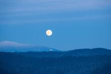Full Moon Rising Over Winter S...