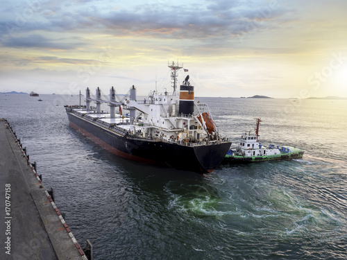 Valokuvatapetti General cargo vessel during alongside at port of thailand and assist by tugs