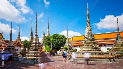 Poster Bangkok Buddhist Stupas at Wat Pho in Bangkok, Thailand (blurred faces)